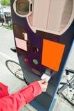 Person Hands Paying For Parking Imágenes de archivo libres de regalías