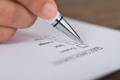 Person Hands With Pen Over Customer Survey Form Stock Images