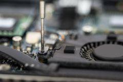 Person Hands Repairing Laptop Motherboard Stock Photography