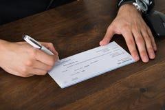 Person Hands Signing Cheque Fotografía de archivo