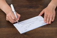 Person Hands Signing Cheque Royalty Free Stock Images