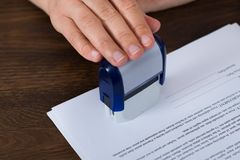 Person Hands Stamping Document Foto de Stock Royalty Free