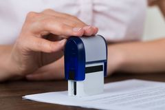Person Hands Stamping Document stock photography