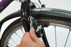 Person Hands Tightening Bolt Of Bicycle Tire Stock Photo
