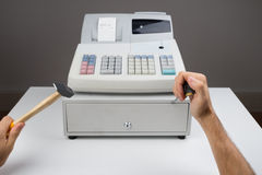 Person Hands With Worktool And Cash Register Stock Image