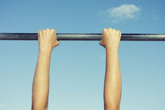 Person hanging on horizontal bar Royalty Free Stock Photos