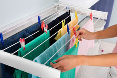 Person Hanging Wet Cloth On Clothes Line Royalty Free Stock Photos