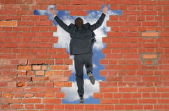 Person has jumped through a brick wall Stock Image