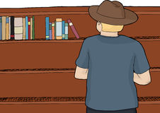 Person in Hat Browsing Books Royalty Free Stock Photos