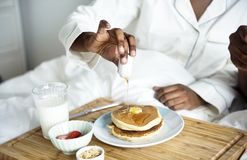 A person having breakfast in bed Royalty Free Stock Photos