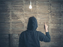 Person having an idea under a light bulb Stock Photo