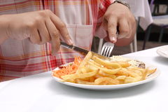 Person having a meal in restaurant Royalty Free Stock Images
