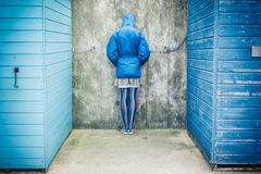 Person with head against the wall outside Stock Photo