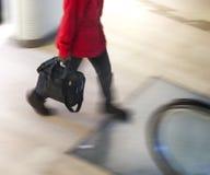 Person heading for escalators Stock Photography