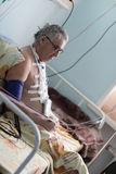 Person after heart surgery. In a hospital ward royalty free stock photo