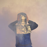 Person with heat protection suit and helmet Stock Photo