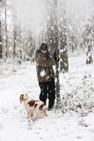 Person and his dog play with snow Stock Images