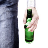 Person hold the Beer. Person hold a Beer Bottle Close-up on the White Background Royalty Free Stock Image