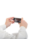 Person hold a Cellphone. Person take a Picture with a Cellphone Isolated on the White Background Stock Photo