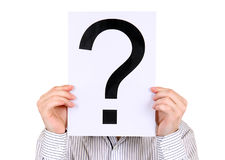 Person hold Question Mark. Person hold the Paper with a Question Mark on the White Background Stock Photography