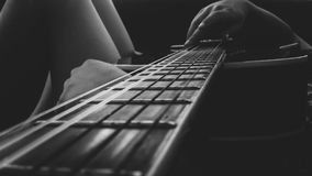 Person Holding an Acoustic Guitar Stock Image