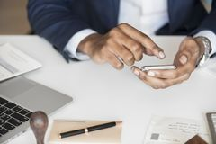 Person Holding Android Smartphone While Leaning on Table Royalty Free Stock Photography