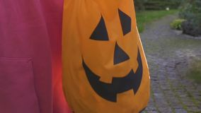 Person holding bag for trick or treat game, Halloween eve celebration, party. Stock footage stock footage