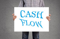 Person holding banner with cash flow message. Stock Image
