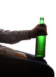 Person holding Beer Bottle. Silhouette of Person with Beer Bottle Close-up Royalty Free Stock Image