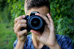 Person Holding Black Canon Dslr Camera Stock Images