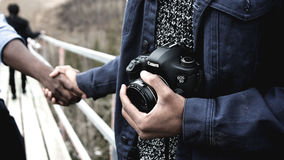 Person Holding Black Canon Dslr Camera Wearing Blue Blazer during Daytime Royalty Free Stock Photography