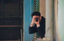 Person Holding Black Dslr Camera Stock Photos