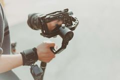 Person Holding Black Dslr Camera royalty free stock images