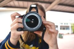 Person Holding Black Dslr Camera Royalty Free Stock Photo