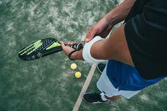 Person Holding Black and Green Tennis Racket royalty free stock images