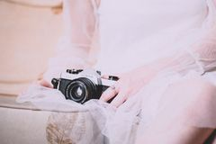 Person Holding Black Mirrorless Camera royalty free stock photography