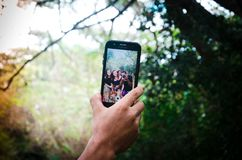 Person Holding Black Smartphone royalty free stock photos