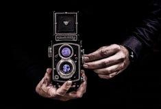 Person Holding Black Twin-lens Reflex Camera Stock Photo