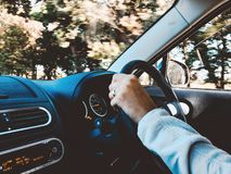 Person Holding Black Vehicle Steering Wheel stock images