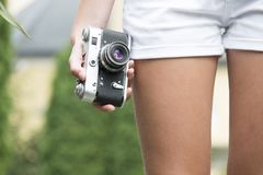 Person Holding Black and White Camera Royalty Free Stock Image