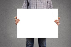 Person holding blank white banner with copy space Royalty Free Stock Photography