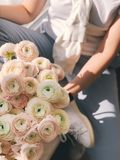 Person Holding Bouquet of Pink and Green Flowers Royalty Free Stock Images