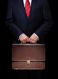 Person holding a briefcase Stock Photo