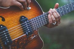 Person Holding Brown and Black Electric Guitar Royalty Free Stock Photo