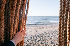 Person Holding Brown Rope on Beach Shore during Daytime Stock Photography