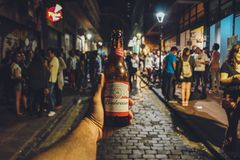 Person Holding Budweiser Bottle Royalty Free Stock Images