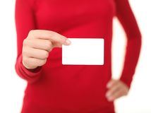 Person holding business card. Blank white business sign and unrecognizable wowan in red. Isolated on white background. Shallow depth of field Royalty Free Stock Photo