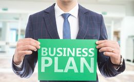 Person holding business plan paper stock image