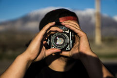Person Holding a Camera Under the Blue Sky during Day Time Royalty Free Stock Photo