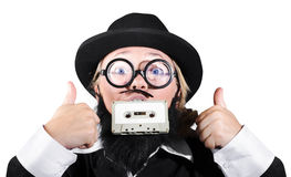 Person Holding Cassette In Mouth With Showing Thumb Up Sign Stock Image